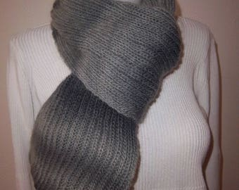 Long and warm woolen scarf.