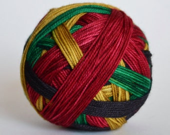 """Ready to Ship! Skein: """"**Mistletoe (4 color self-striping)"""" - Black, Emerald Green, Gold, Deep Red Stripes"""
