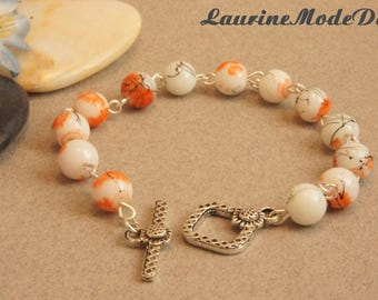 Orange and black spotted white glass beads bracelet