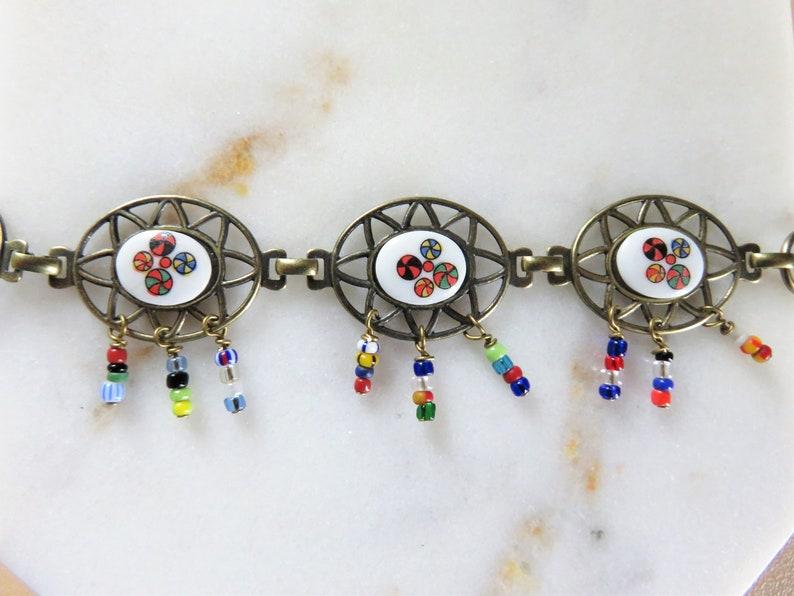 B455 Unique Filigree Glass Fringe Link Bracelet Vintage Oval Mod White Colorful Design Gold Seed Fold Over Boho Gypsy Cutout Dangle Fun Mix