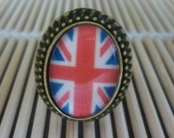 Ring adjustable oval brass English flag pattern.