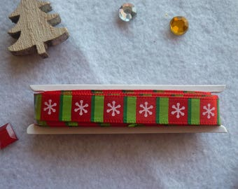 Satin ribbon on red and green bands, snowflakes, Christmas, the meter theme.