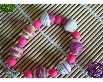 Recycled paper beads bracelet in white and pink and fluorescent pink acrylic beads.