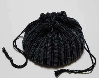 The Dover, a bead knit, handmade pouch purse fully lined in black