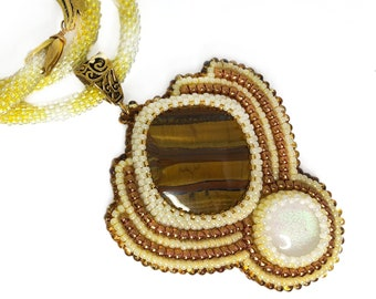 Elegant bead embroidered pendant with tiger eye healing crystal
