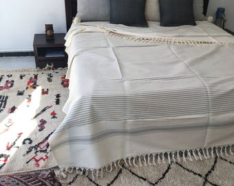 100% Coton throw  with frange hand loomed by our weavers , size 118x94'' inches