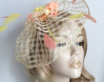 d819b7f1ae067 IVORY FLOWER FASCINATOR, Made with mesh sinamay, feathers , assorted flowers  ,on a headband