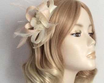 PEACH and IVORY FASCINATOR, Made of Sinamay, with Chiffon flower,crystal and pearl detail, Feathers,on a comb