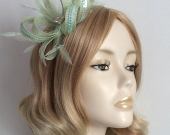 MINT GREEN FASCINATOR, with feathers, sequins, Square of crystals, Mounted on narrow silver headband
