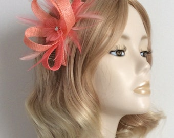 CORAL FASCINATOR, Made of two tone sinamay , with flower,crystal, Feathers,on a comb