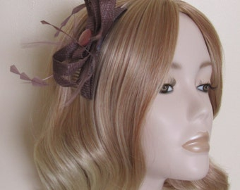 TAUPE SINAMAY FASCINATOR, Cut coque Feathers, Flat bead, on a 4in clear comb