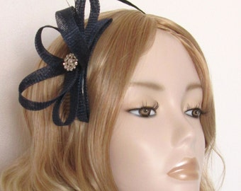 NAVY BLUE FASCINATOR, Made of Sinamay, coque feathers, Crystal and pearl detail, on a comb
