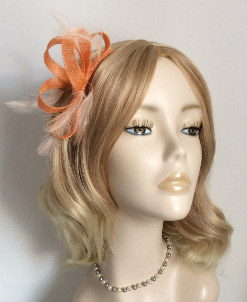 APRICOT and PEACH FASCINATOR with Peach Stripped hackle Feathers,organza and beaded flower,on a comb