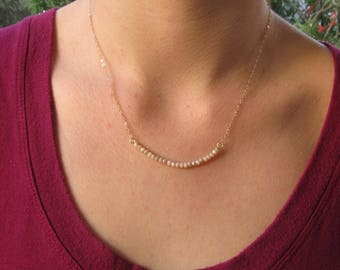 Sun Kissed Gold Beaded Trapeze Necklace