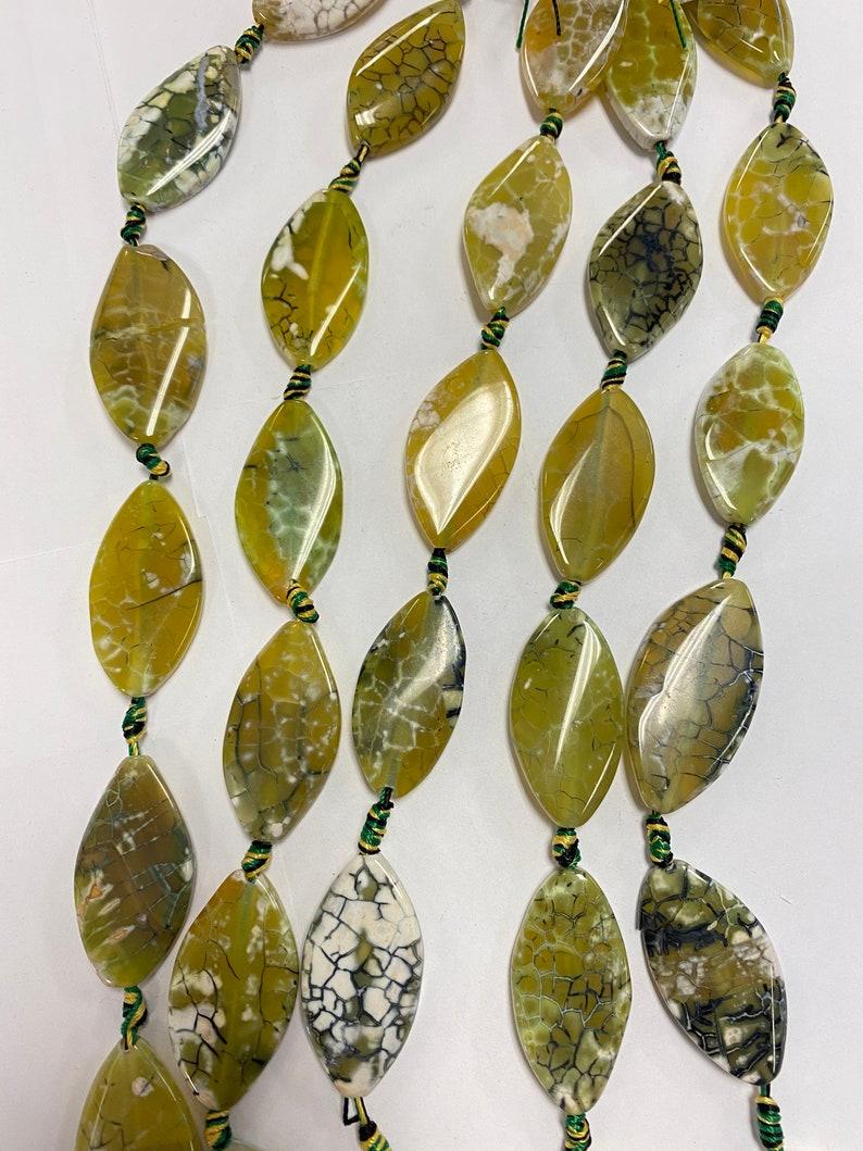 Fire Agate 35x20x5mm Flat oval Gemstone beads 15 inch strand 1 strand 3 strands
