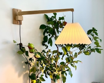 Danish handmade solid oak, wall swing light with a natural white chintz, pleated lampshade.