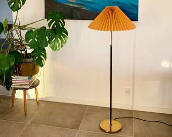 Danish mid-century black and brass floor lamp, height adjustable, with new ochre yellow linen, pleated shade.