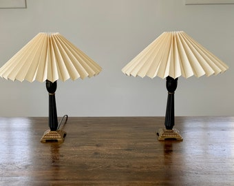 Pair of vintage Danish, black wood and brass table lamps with cream pleated, linen lampshades.