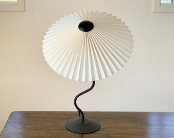 Clip on shade: New Eclipse, knife pleated lampshade, available in several sizes, for table lamps, floor lamps or wall lights. Danish design.