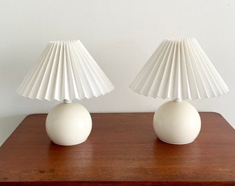 Pair of vintage Danalux, white metal ball table lamps with new pleated, white linen lampshades.