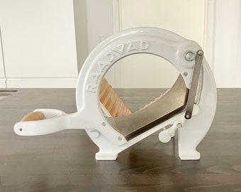 White Danish Raadvad bread slicer / vegetable cutter / cookbook display with beech deck. Made in Denmark.