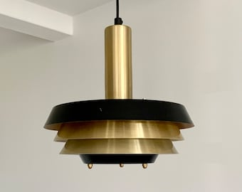 Vintage Danish ceiling pendant light in black and brass alloy. Multiple tiers of shade for optimum light distribution.