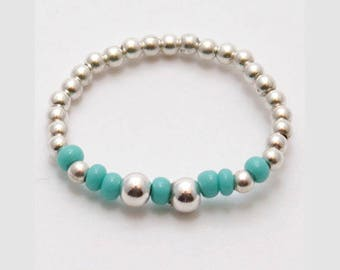 Ring top elastic fancy turquoise seed beads range