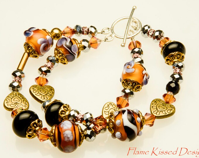 Featured listing image: TIGER LILLY...An artisan handcrafted double strand Lampwork glass bead bracelet