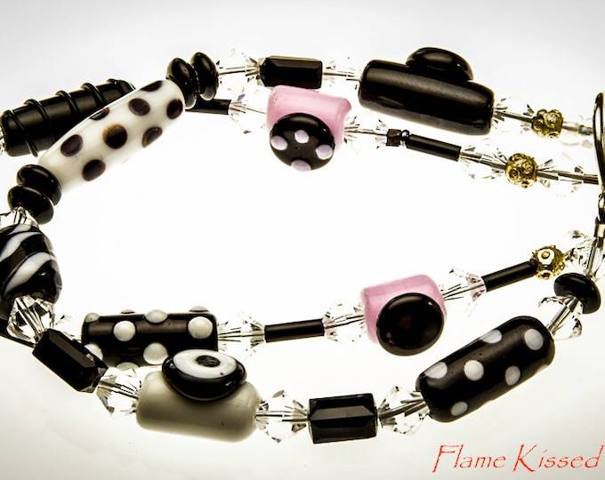 Featured listing image: JITTERBUG!....A double strand artisan crafted lampwork glass bead bracelet.
