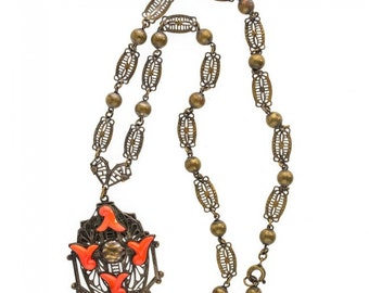 Neiger Brothers red coral glass and brass filigree lavaliere necklace c. 1930's. nlbg2076