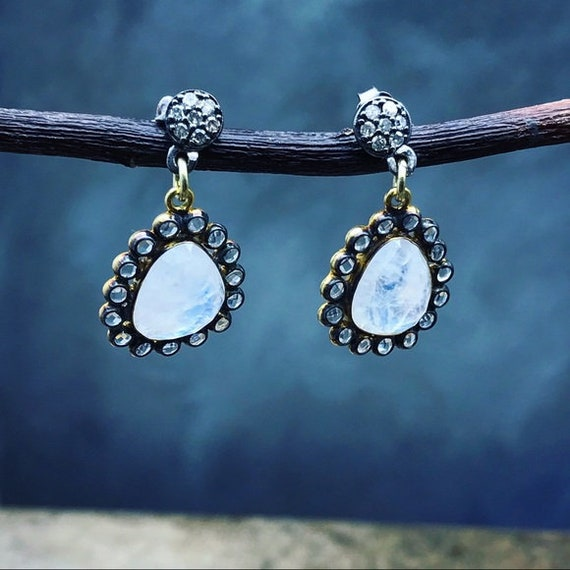 Diamonds moonstones and topaz earrings