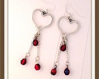 Handmade MWL long dangle heart and red beaded earrings. 0034