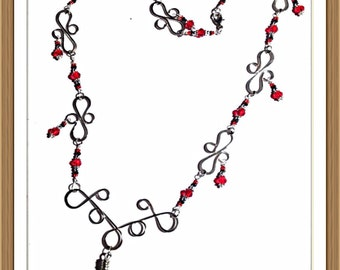 Handmade MWL forged wire frame with red and black beaded necklace. 0127