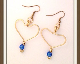 Handmade MWL forged heart earrings with blue bead. 0101