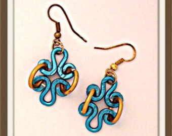 Handmade MWL forged one of a kind short dangle warrings. 0141