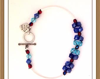 Bracelet Handmade by MWL two tone blue and red beaded bracelet. 0200