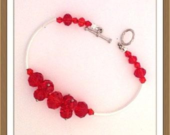 Bracelet by MWL red faceted beaded bracelet. Handmade 0180