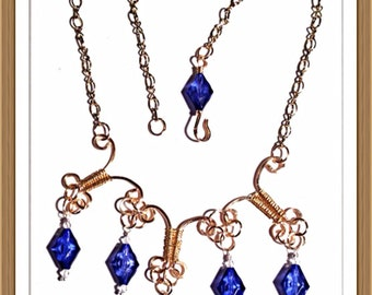 Handmade MWL firged gold wire with blue beads. 0140
