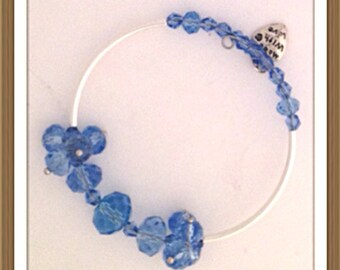 Bracelet Handmade by MWL blue faceted and silver tube beaded bracelet. 0207