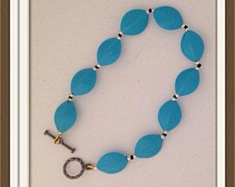 Bracelet Handmade by MWL oval aqua and silver beaded bracelet. 0197