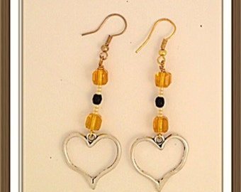 Handmade MWL long dangle yellow ocher, black and silver pierced earrings with heart. 00001