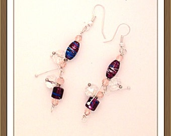 Handmade MWL purple and champaign beaded twig earrings. 0122