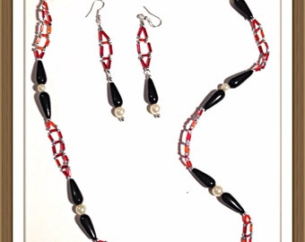 Handmade MWL red, black, silver and white ladder necklace. 0064