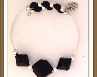 Bracelet Handmade bu MWL black faceted beads and silver beaded bracelet. 0214