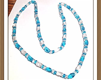 Handmade MWL blue and clear faceted beads on stretch cord. 0265