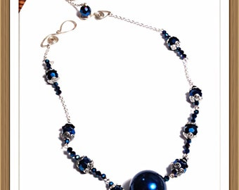 Handmade MWL blue faceted beads with silver end caps and forged clasp clisure. 0270