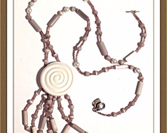 Handmade MWL violet beaded necklace with center button. 0067