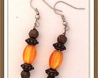 Handmade MWL orange and brown dangle earrings. 0078