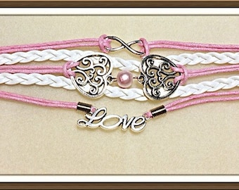 Bracelet by MWL 5 line braided bracelet with infinty, hearts, love and pearl.