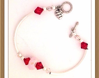 Bracelet by MWL pink, red and silver bracelet. Handmade 0231